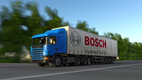 Freight semi truck with Robert Bosch GmbH logo driving along forest road Live Action