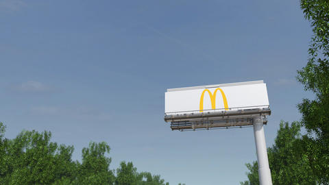 Driving towards advertising billboard with McDonald's logo. Editorial 3D Footage