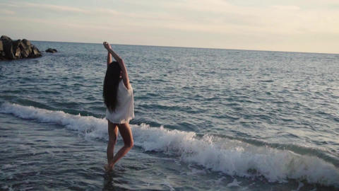 beautiful girl on the seashore enjoying the beautiful... Stock Video Footage