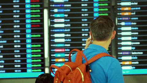 Muslim Women Tourist Checking Flight Information Board Live Action