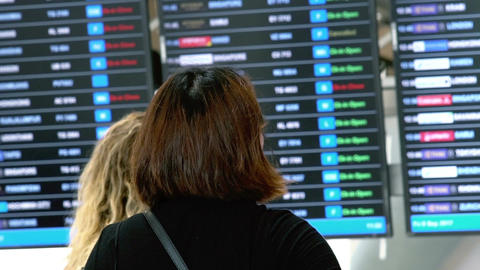 Muslim Women Tourist Checking Flight Information Board Footage