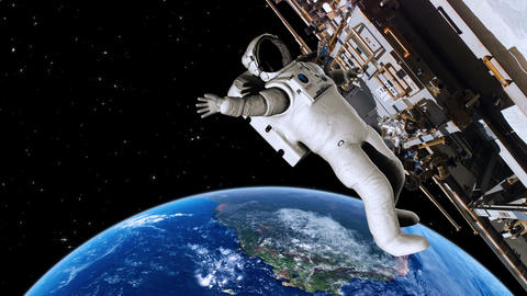 Astronaut Working On The International Space Station Waving - 4K stock footage