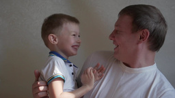happy father and son joking, having fun, laughing, smiling Footage