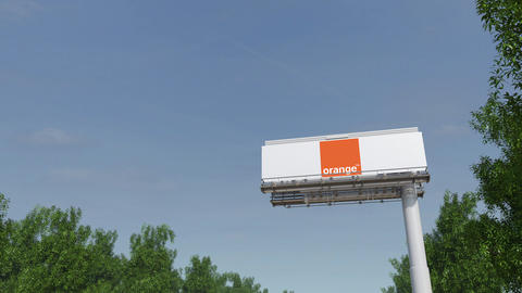 Driving towards advertising billboard with Orange S.A. logo. Editorial 3D Footage
