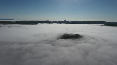 Fog between mountains in Tuscany, Italy. Aerial Footage
