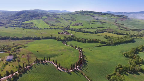 Tuscany aerial landscape with road and cypresses Footage