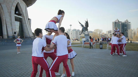 Slow Motion Acrobats Perform Acrobatic Feat near Wedding Palace Footage