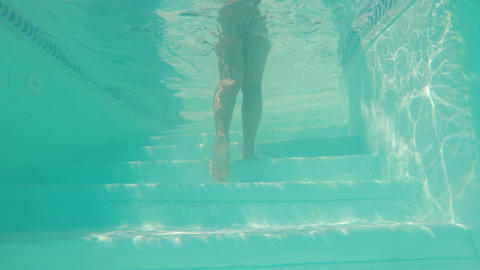 Underwater camera inside the pool with body of an attractive sexy woman Footage