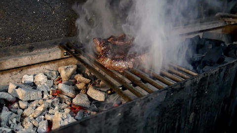 From coals there is a heat and smoke on the roast meat Footage