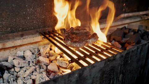 Meat is fried on fire Archivo