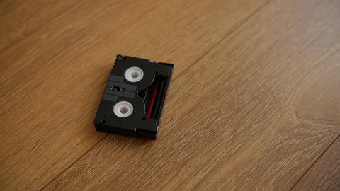 Mini DV cassettes falling on the floor Live Action