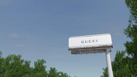Driving towards advertising billboard with Gucci logo. Editorial 3D rendering 4K Live Action