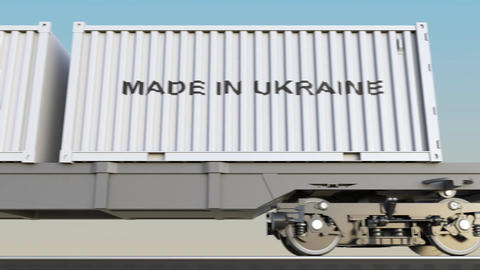 Moving cargo train and containers with MADE IN UKRAINE caption Footage