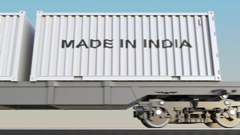 Moving cargo train and containers with MADE IN INDIA caption Footage