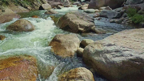 Closeup Stormy Mountain River Runs between Boulders Footage