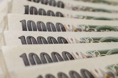 Banknotes of Japanese yen currency background Photo