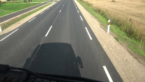Bus shadow on asphalt road, speed background Live Action