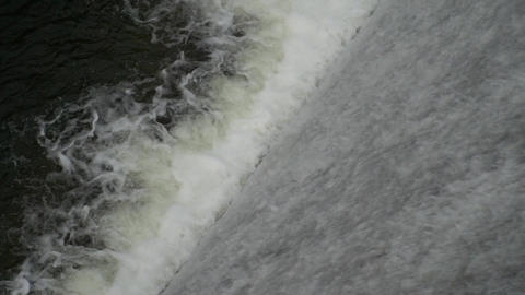 Water flow over spillway,Electrical power station Footage