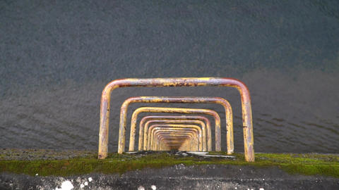 Staircase with water flow over spillway Footage