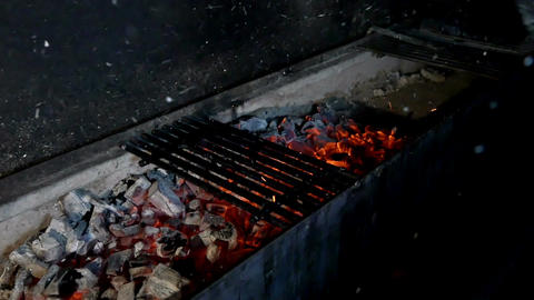Chef inflates the coals in the grill Footage