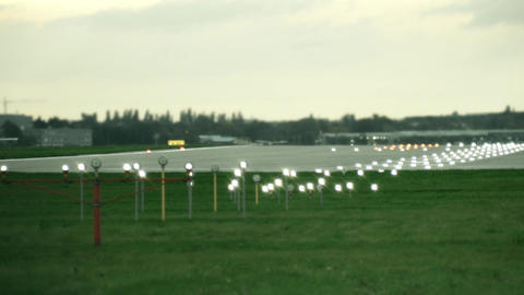 Lit airport runway in the evening Footage