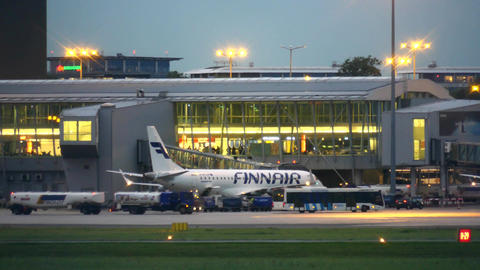 WARSAW, POLAND - SEPTEMBER 14, 2017. Finnair Oyj commercial airplane boarding at Footage