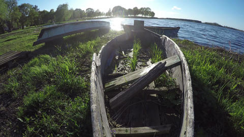 old wooden fishing broken boats on lake coast Footage