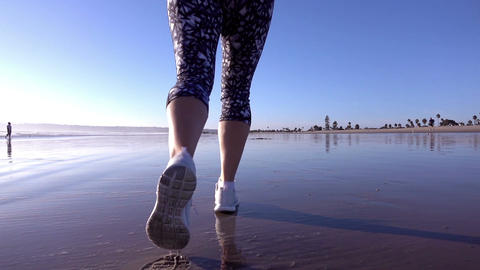 Video of woman running at the beach in real slow motion Footage