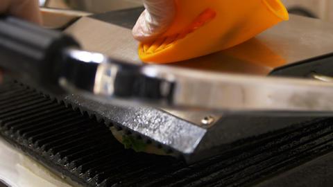 Closeup Chief Puts Hamburger on Roasting Machine Footage