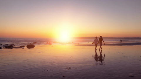 Video of couple walking at the sunset in real slow motion Footage