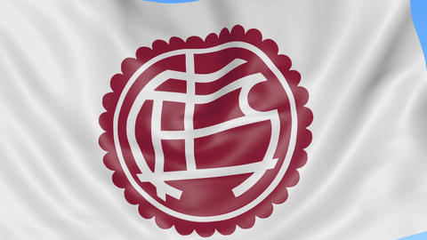 Close-up of waving flag with Club Atletico Lanus football club logo, seamless Live Action