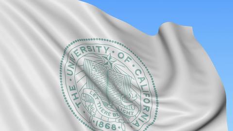 Close-up of waving flag with University of California San Francisco emblem Archivo