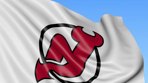 Close-up of waving flag with New Jersey Devils NHL hockey team logo, seamless Footage