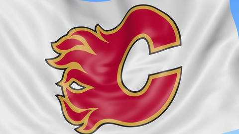 Close-up of waving flag with Calgary Flames NHL hockey team logo, seamless loop Footage
