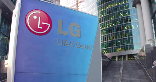 Street signage board with LG Corporation logo. Modern office center skyscraper Footage