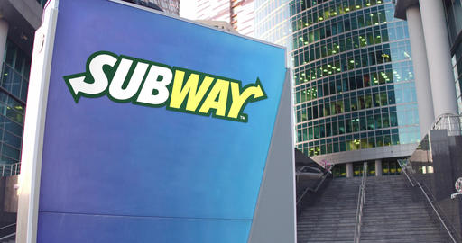 Street signage board with Subway logo. Modern office center skyscraper and Footage