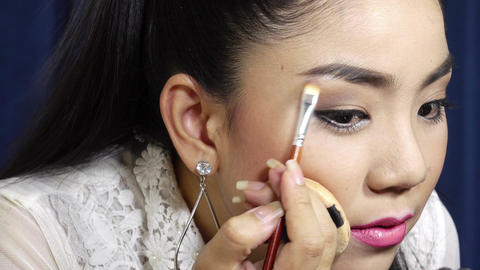 Multi-make-up,Brunette woman applying make up Footage