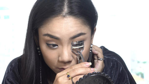 make up using eyelash curler Footage