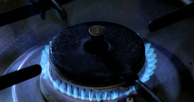 Turn on the Burning gas stove in the kitchen at blue fire Footage