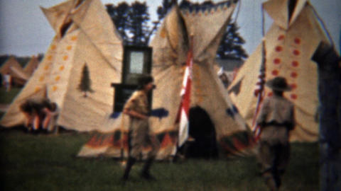 1945: Boy Scouts exploring Indian teepee village exhibit display Footage