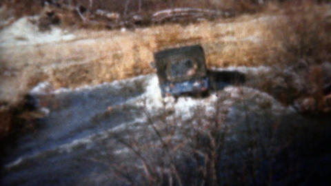 1962: Jeep driving thru deep water across to safe dry land Footage