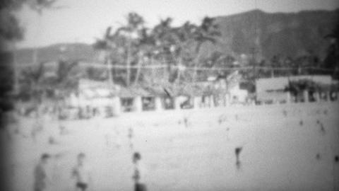 1953: Waikiki beach underdeveloped diamondhead visitors playing Footage