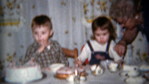 1962: Mom serving children ice cream at family kitchen table Footage