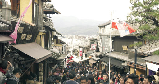 Crowds of people walking through ancient Kyoto Streets Footage