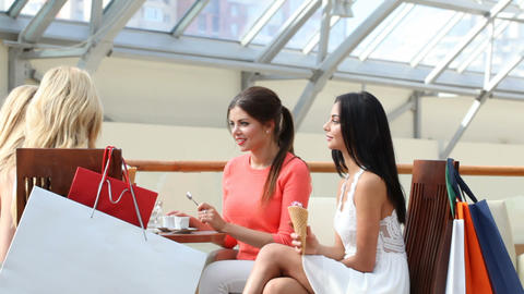 Women in cafe after shopping Footage
