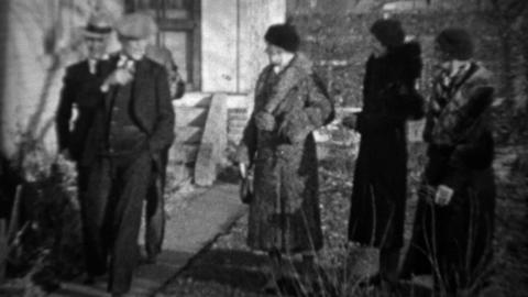 1933: Men greeting women tipping cap bowing to pretty wifes Footage