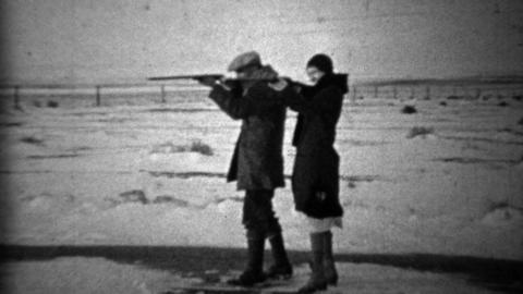 1933: Bonnie & Clyde depression era couple posing with guns Live Action