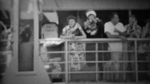 1953: Flower lei necklace couple on cruise ship headed to mainland Footage