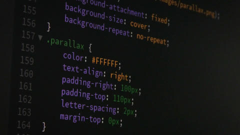 Programmer scrolling up and down for editing page of html css website code Footage