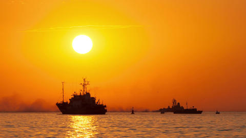 Boats floating on the sea at sunset Filmmaterial